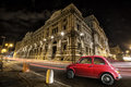 Picture : Old car Italian red by night. Italian historic monument