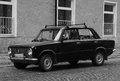 Old car lada parked in front of building black white Royalty Free Stock Photography