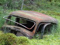 Old car in morass the rusty is slowly sinking the Royalty Free Stock Images