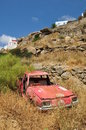 Old car neglected in mykonos greece Royalty Free Stock Photos