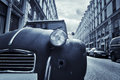 Old car in the street of Paris Stock Image