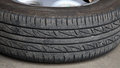 Old car tire with steel rim Stock Images