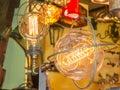 Old carbon light bulb filament amber edison Stock Photos