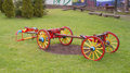 Old carriage carts repaired and painted in various shades of colors on display in the city park as decoration and memories of the Royalty Free Stock Photos