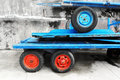 Old carts with wheels and vivid colors on port Royalty Free Stock Images
