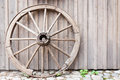 Old cartwheel leaning against wall wooden Royalty Free Stock Photography