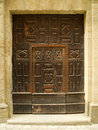 Old carved door in stone wall Royalty Free Stock Photos