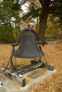 Old cast iron churchbell large church bell in a rural setting in connecticut in autumn Stock Photos