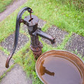 Old cast iron water pump and tub sq Royalty Free Stock Photo