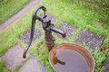 Old cast iron water pump wet in garden Stock Photography