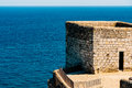 Old Castle Stone Wall And Tower With Ocean Landscape Royalty Free Stock Photo