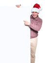 Old casual santa man is pointing to a big blank billboard and smiles Royalty Free Stock Photos