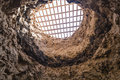 Old cave fuerteventura an covered with a wooden grid to protect people from falling into it seen in ajuy in spain Stock Photo