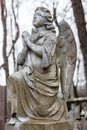 Old cemetery marble sculpture of the angel