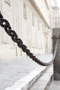 Old chain in seville barrage on street against background with cathedral wall spain europe Royalty Free Stock Image