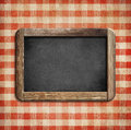 Old chalkboard on picnic tablecloth red Royalty Free Stock Image