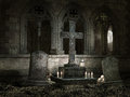 Old chapel with candles at night tombstones and skulls Stock Photography