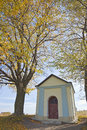 Old chapel outdoor christian in autumn against blue sky Stock Image