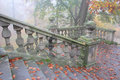 Old chateau banister in misty autumn park forest Stock Photos