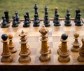 Old chess defective game made of wood standing in the open Royalty Free Stock Image