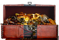 Old chest filled with Baltic amber Stock Images