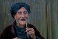 Old chinease man laughing with a pipe Royalty Free Stock Photo