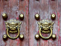 Old chinese door ornament lion knockers Stock Photography