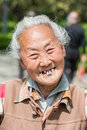 Old chinese woman friendly toothless toothy smiling outddors por shanghai china april portrait at the city of shanghai in china on Royalty Free Stock Images