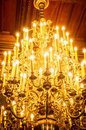 Old chrystal chandeliers with ambient light close up Stock Image