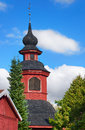 Old church belltower from th century against blue sky with copy space Stock Images