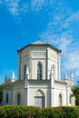 Old church building in neoclassical style with stained glass window under blue sky Stock Image