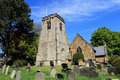 Old church and cemetery scenic view of village with in foreground england Royalty Free Stock Image