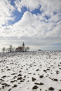 Old church outdoor in winter against blue sky with clouds Royalty Free Stock Photography