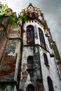 Old church in perspective abandoned with dilapidated facade Royalty Free Stock Photos