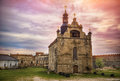 Old church in ruins facade of ancient fortress under colorful cloudy sky Royalty Free Stock Photo