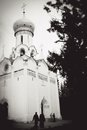 Old church seen thgrough tree trunks trinity sergius lavra sergiev posad russia unesco world heritage site black and white photo Royalty Free Stock Image