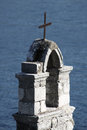 Old church on shore built from stone sea in boka bay in montenegro Royalty Free Stock Image