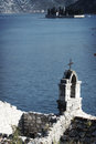 Old church on shore built from stone sea in boka bay in montenegro with st george island in background Royalty Free Stock Image
