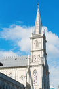 Old church turret in neoclassical style with shutters on window under blue sky Royalty Free Stock Photography