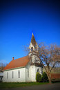 The old church a view of a charming with a large steeple under clear blue skies copy space Royalty Free Stock Photo