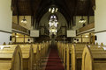 Old church wooden pews red carpet Royalty Free Stock Photos