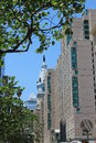 Old city hall tower among modern buildings view of at the end of a row of street summer in philadelphia pennsylvania Stock Photos