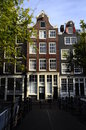 Old city houses along canal in amsterdam holland traditional Stock Photo