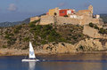 Old city in ibiza sailboat glides by the of an island off the coast of spain Royalty Free Stock Photos