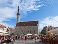 Old city on june in tallinn estonia a crowd of tourists visit town hall square exhibition day the Stock Photo