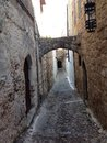 Old city rhodos the arches between the houses prevent them to get offbeat in case of Royalty Free Stock Photography