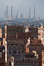 The Old City of Sana'a, decorated houses, palace, minarets and the Saleh Mosque in the fog, Yemen Royalty Free Stock Photo