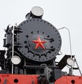 Old classic black soviet steam locomotive with red star on front, close up view on star Royalty Free Stock Photo