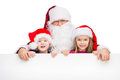 Old classic santa claus hugging two little kids standing with happy smile behind white poster isolated over white background Stock Photography