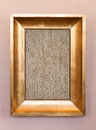 Old classical wooden frame with blank canvas on hanging the wall Stock Images